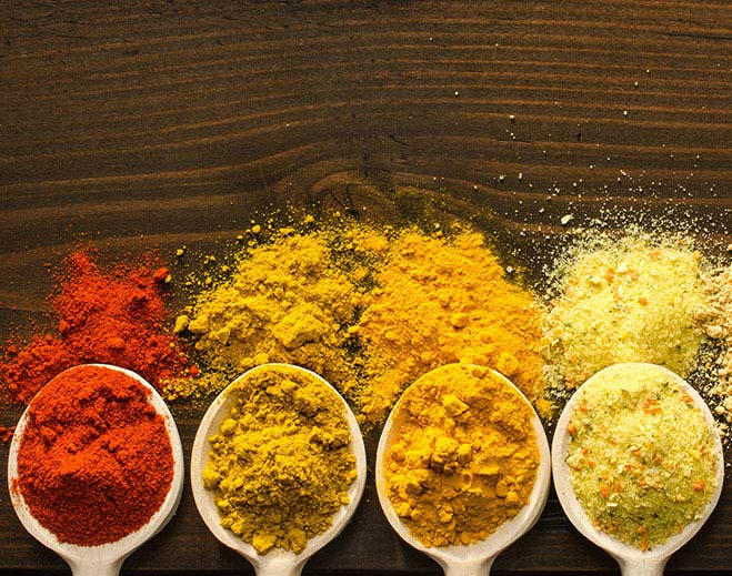 different spices in measuring spoons