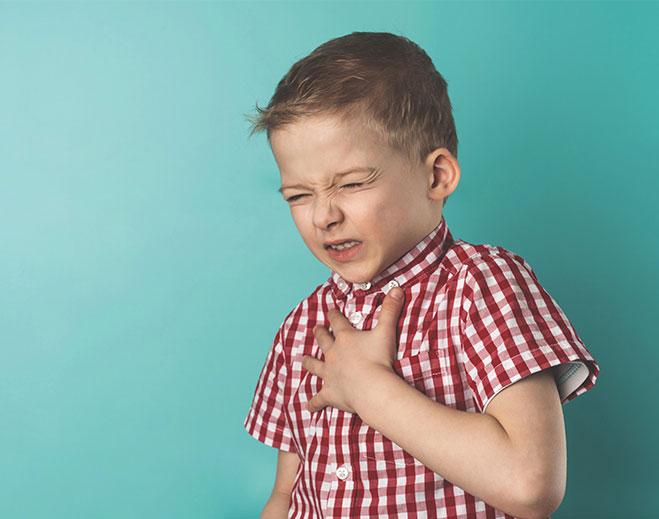 child holding chest